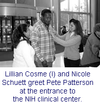 Photo: Lillian Cosme and Nicole Schuett greet Pete Patterson at the entrance to the NIH clinical center.